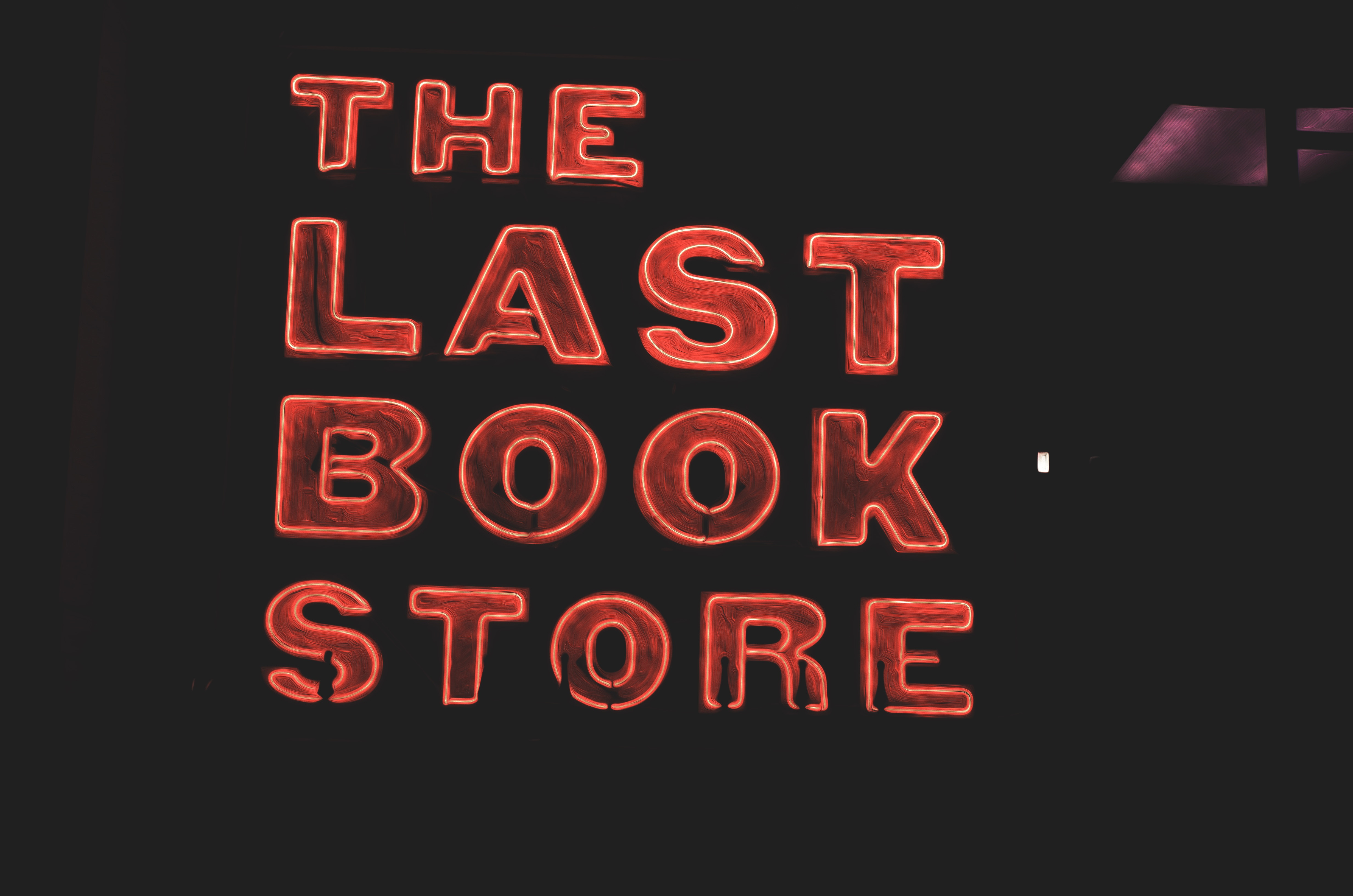 A picture of a neon sign for The Last Book Store
