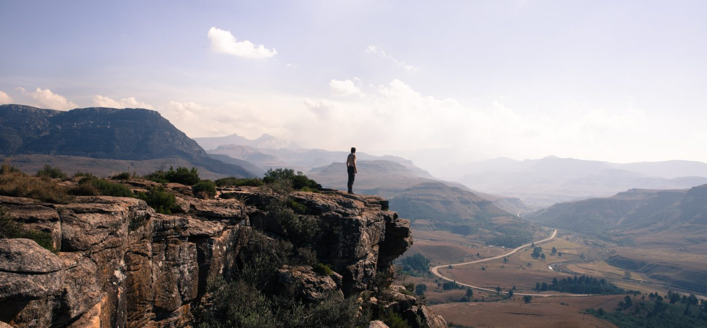 A picture of a person on a cliff edge