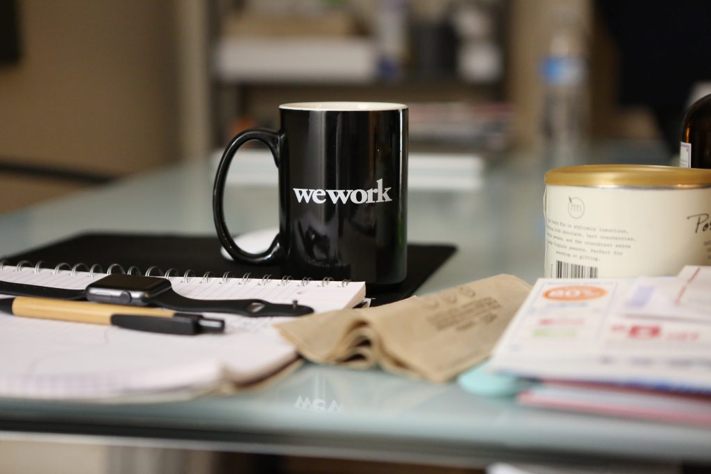 A picture of a mug of coffee on a desk