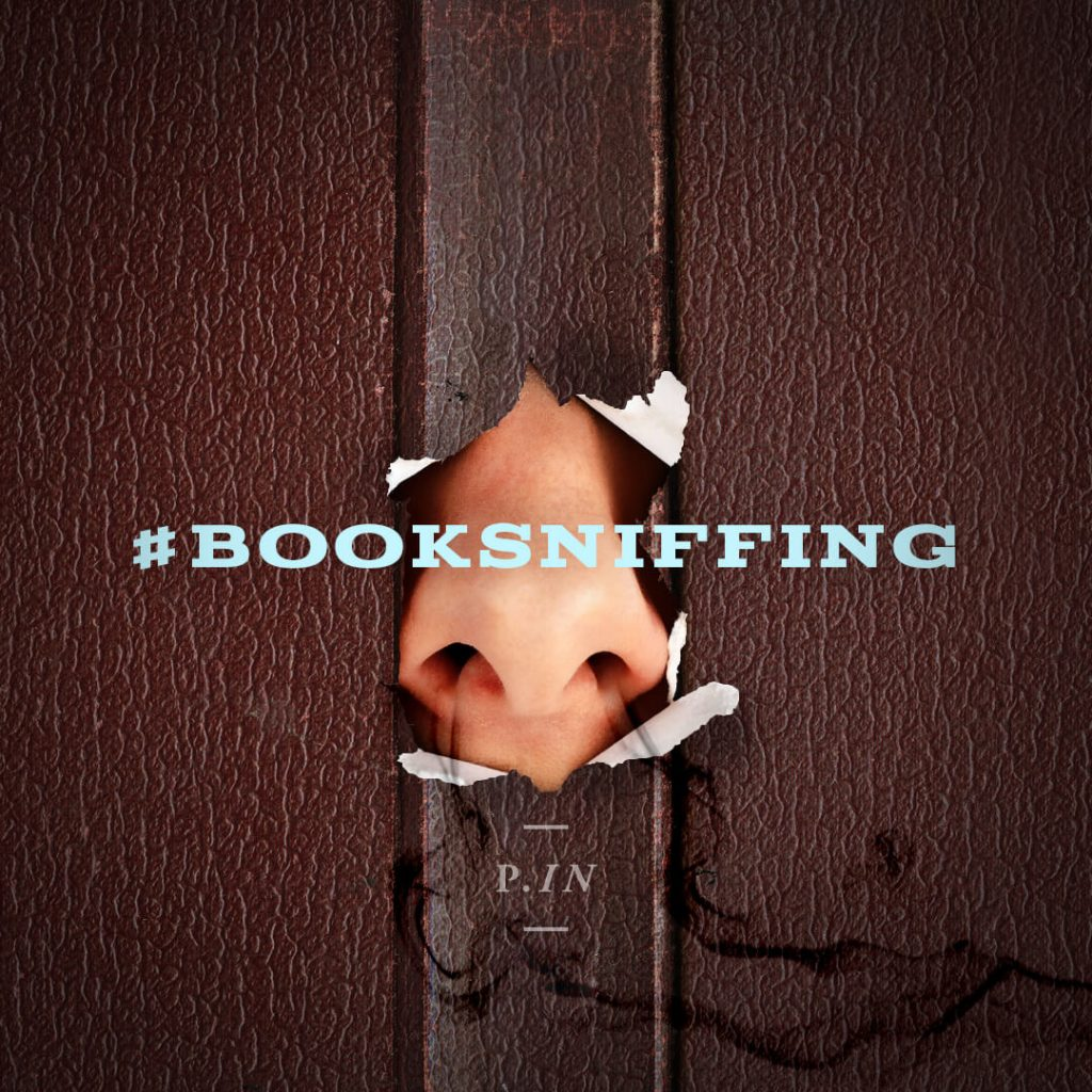 a picture of a nose poking through a book with the hashtag booksniffing