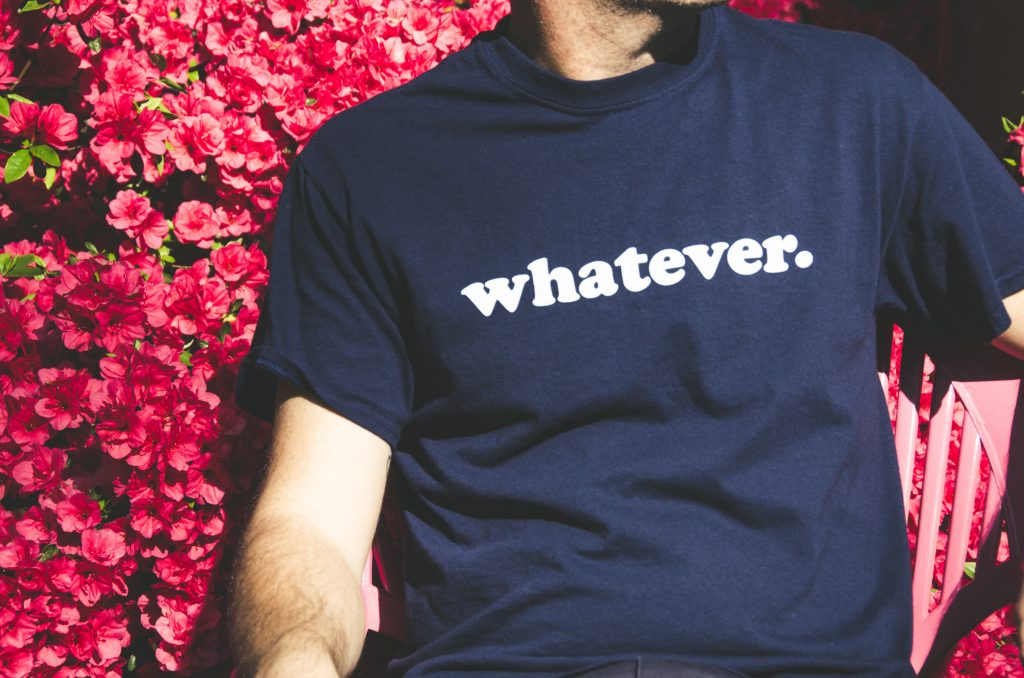 A picture of a tee shirt that says whatever