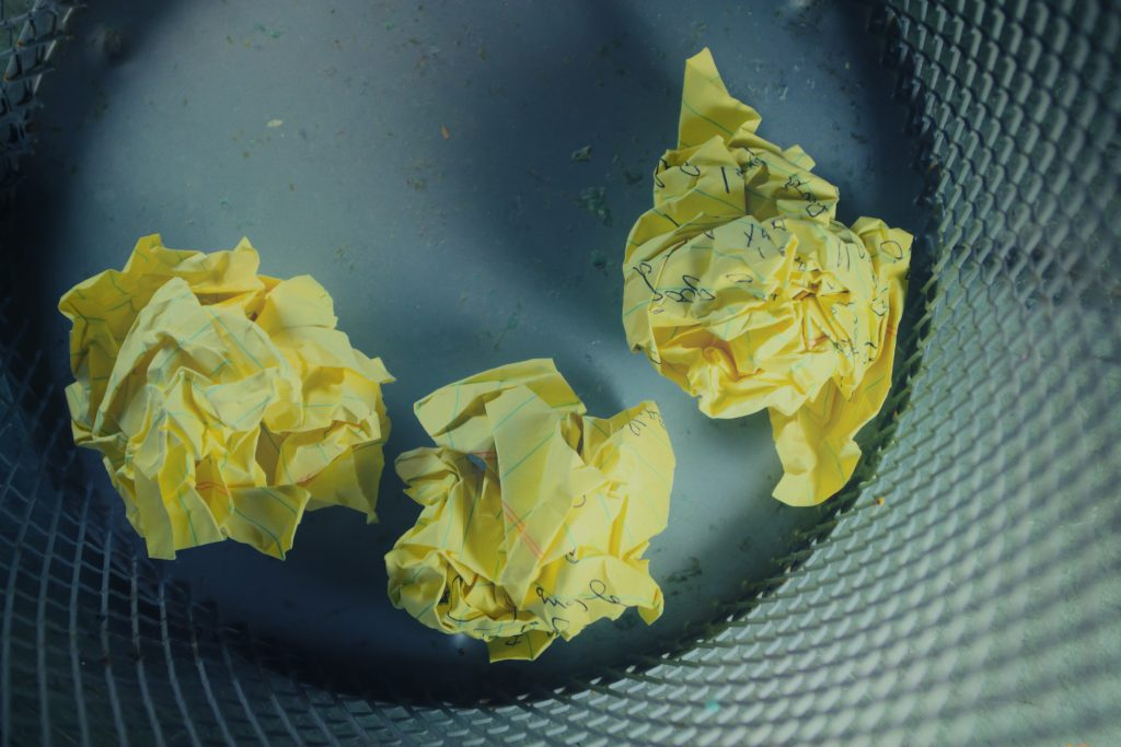 A picture of crumpled paper in a bin