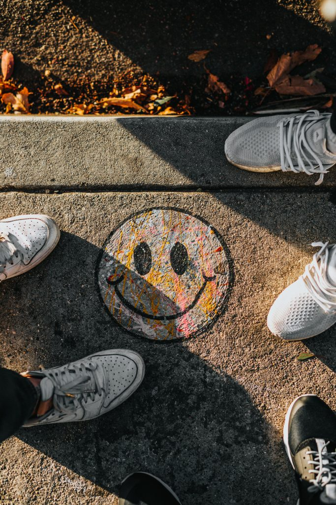 A picture of a smiley face at people's feet