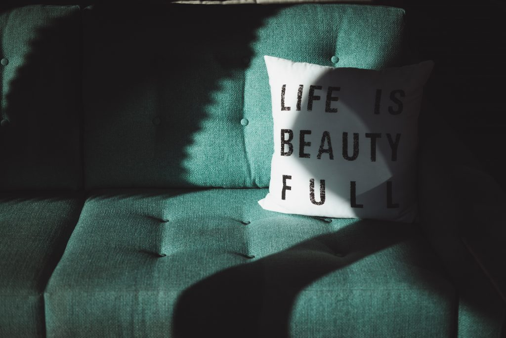A picture of a cushion with Life Is Beauty Full on it